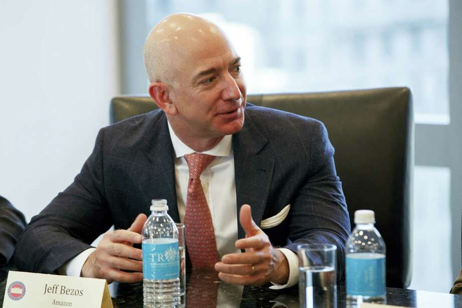 Amazon founder Jeff Bezos speaks during a meeting with President-elect Donald Trump and technology industry leaders at Trump Tower in New York on Dec. 14, 2016. Photo: AP Photo — Evan Vucci  / Copyright 2016 The Associated Press. All rights reserved.
