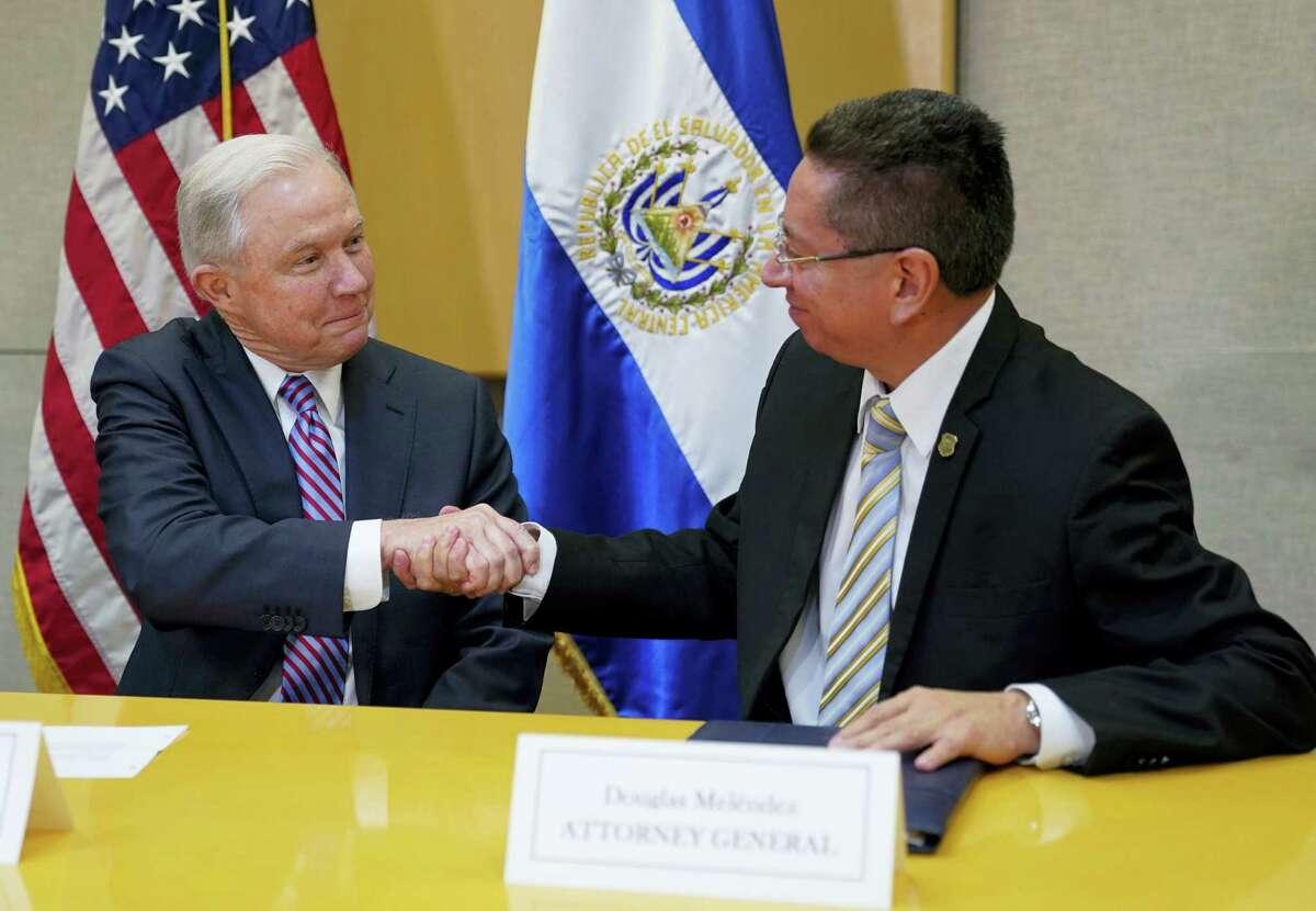 U.S. Attorney General Jeff Sessions shakes hands with El Salvador Attorney General Douglas Melendez Ruiz during their meeting in San Salvador, El Salvador, Thursday, July 27, 2017.