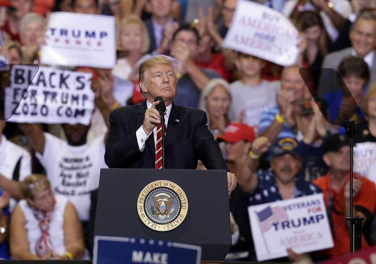 President Donald Trump gestures to the crowd while speaking at a rally at the Phoenix Convention Center, Tuesday, Aug. 22, 2017, in Phoenix. (AP Photo/Rick Scuteri)