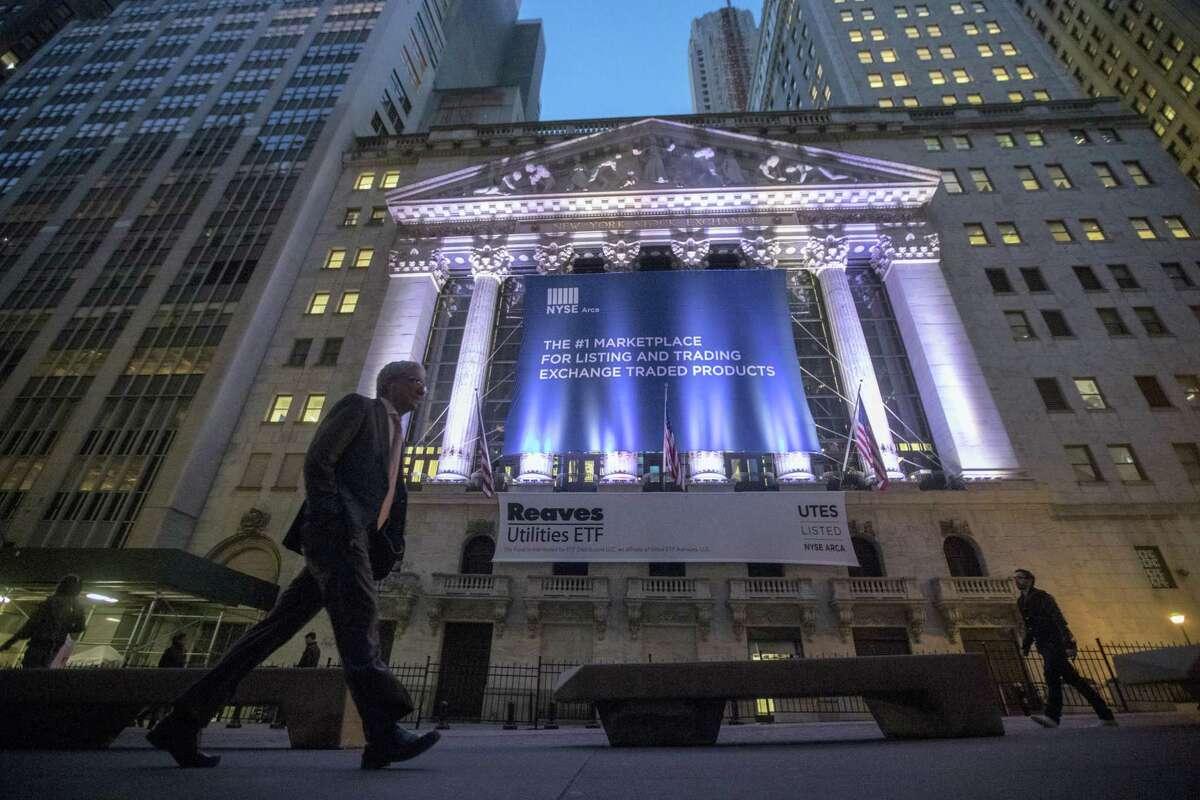 A pedestrian walks past the New York Stock Exchange in lower Manhattan.