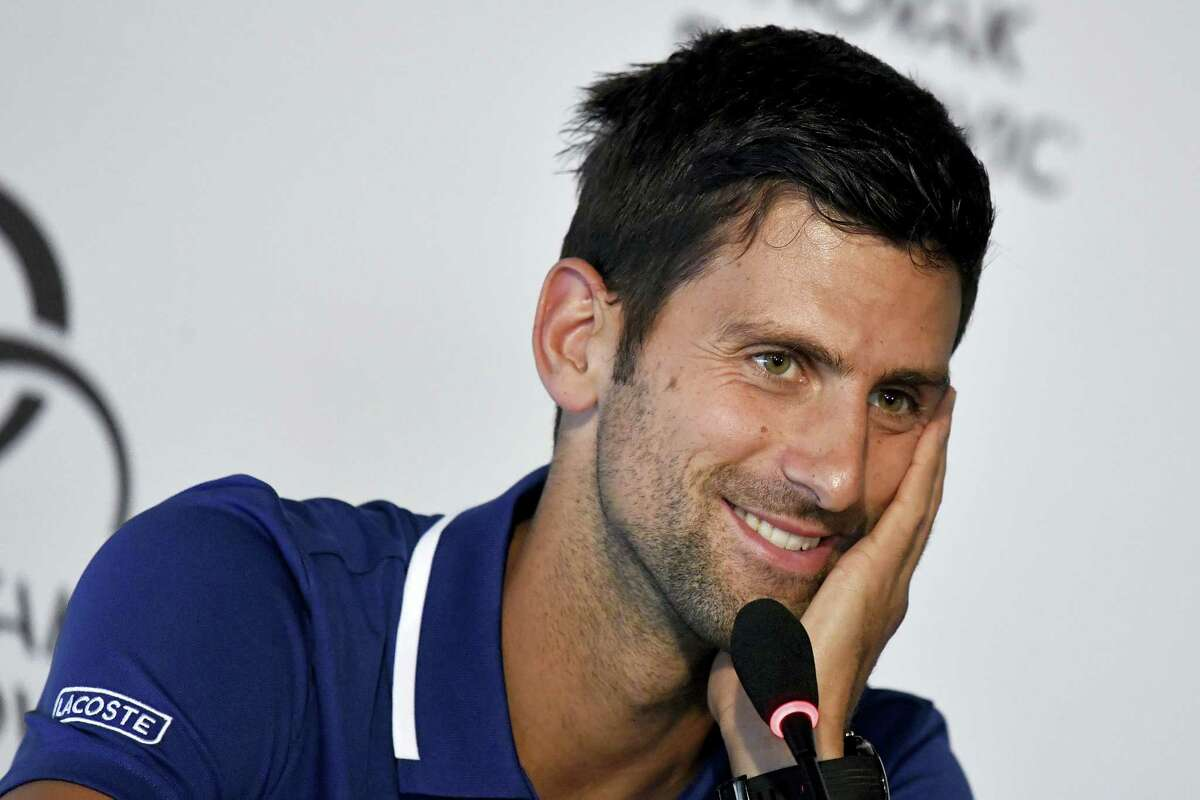 Tennis player Novak Djokovic smiles during a press conference in Belgrade, Serbia on July 26, 2017. Djokovic will sit out the rest of this season because of an injured right elbow, meaning he will miss the U.S. Open and end his streak of participating in 51 consecutive Grand Slam tournaments.