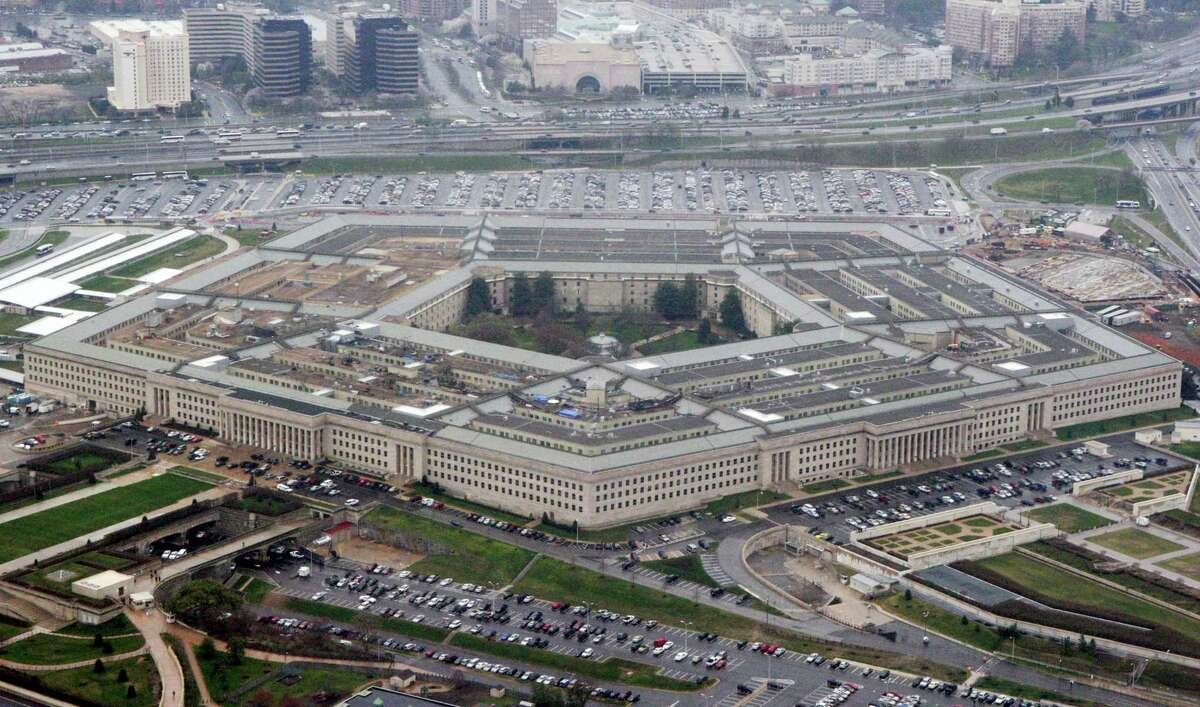 """In this March 27, 2008, file photo, the Pentagon is seen in this aerial view in Washington. President Donald Trump says he will bar transgender individuals from serving """"in any capacity"""" in the armed forces."""