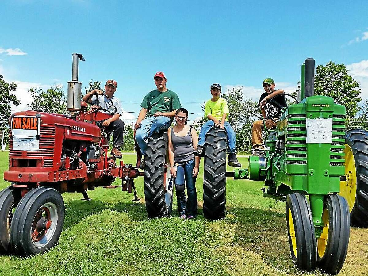 4-H members show off their machinery at the fair.