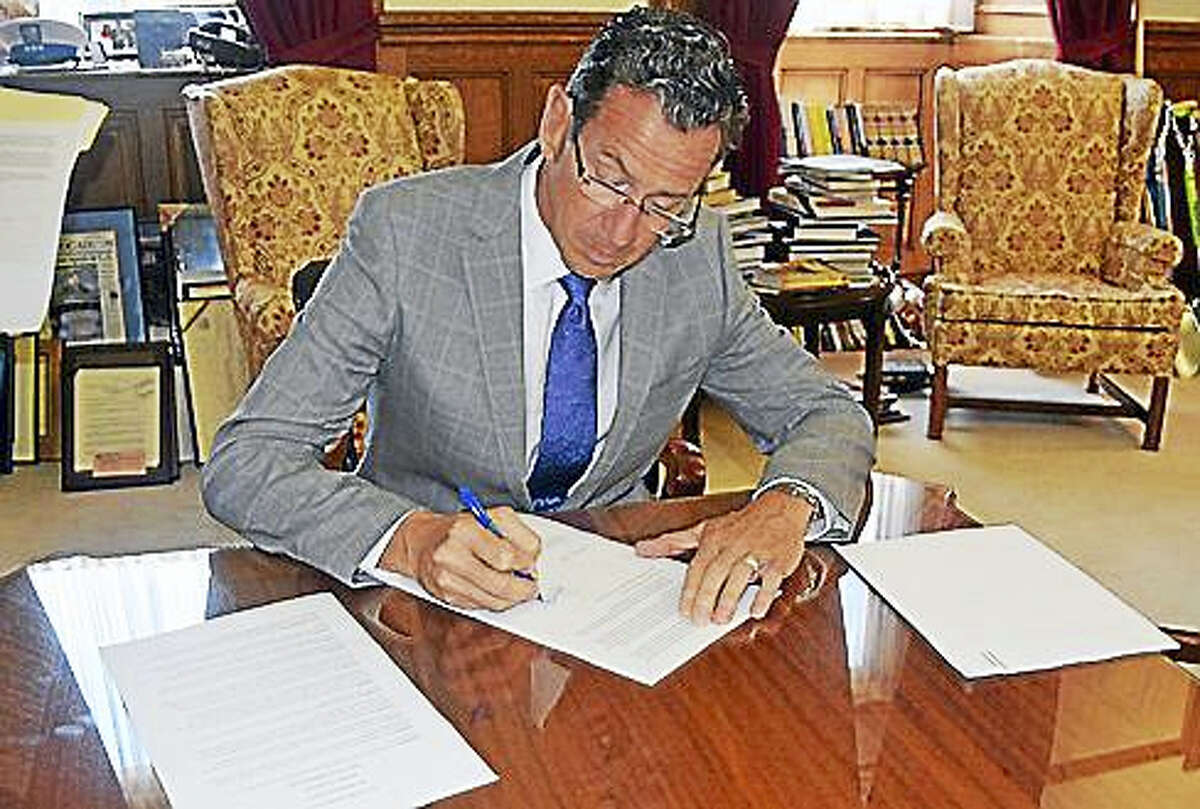 Gov. Dannel P. Malloy signs the executive order.