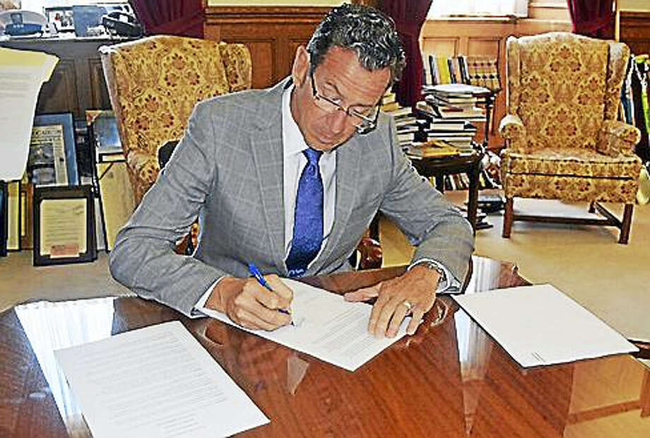Gov. Dannel P. Malloy signs the executive order. Photo: Courtesy Of The Governor's Staff