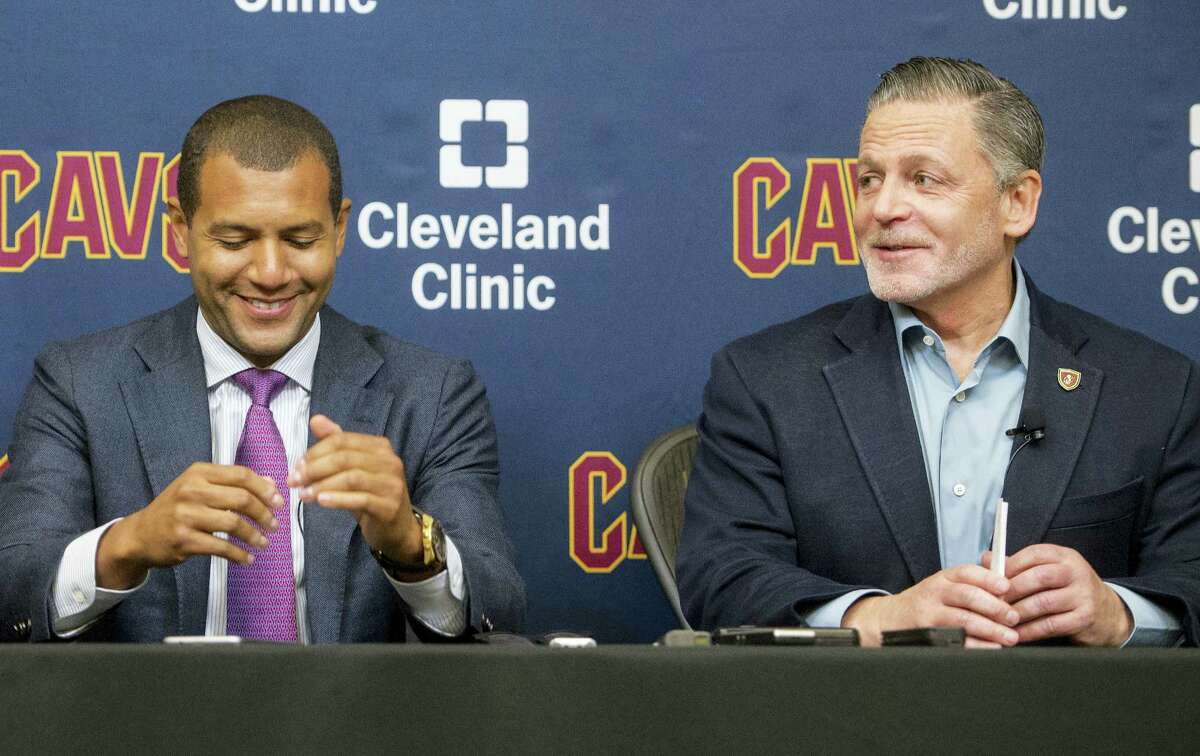 New Cleveland Cavaliers general manager Koby Altman, left, and chairman Dan Gilbert share a light moment during a news conference at the team's training facility in Independence, Ohio, Wednesday.
