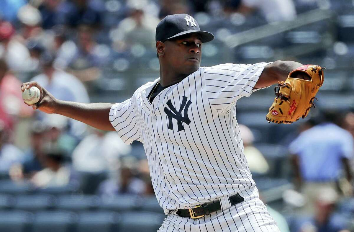 New York Yankees pitcher Luis Severino delivers against the Cincinnati Reds during the first inning of the Yankees' 9-5 victory over the Reds Wednesday at Yankee Stadium.