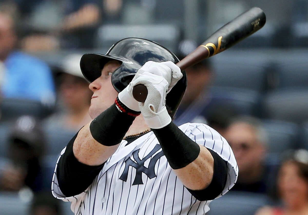 New York's Clint Frazier connects for an RBI single against the Cincinnati Reds during the third inning.