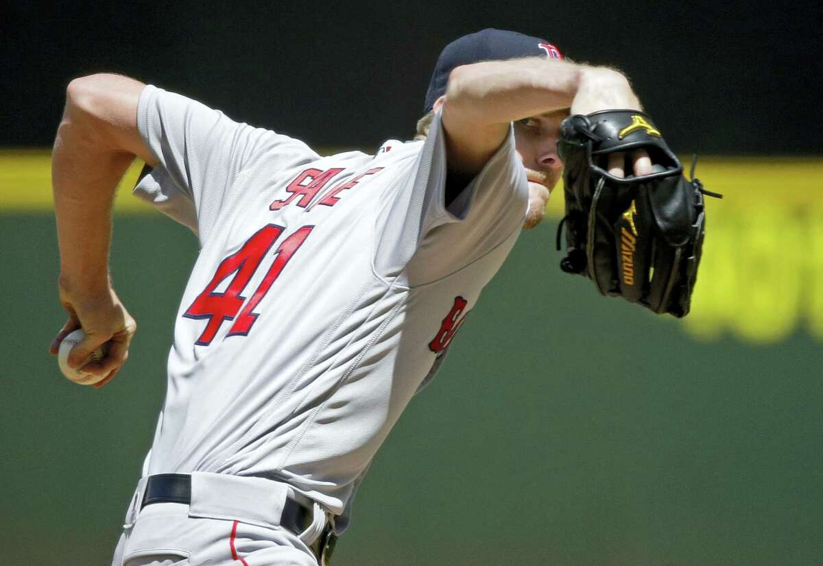 Boston Red Sox starting pitcher Chris Sale throws against the Seattle Mariners in the sixth inning Wednesday in Seattle. The Red Sox won 4-0.