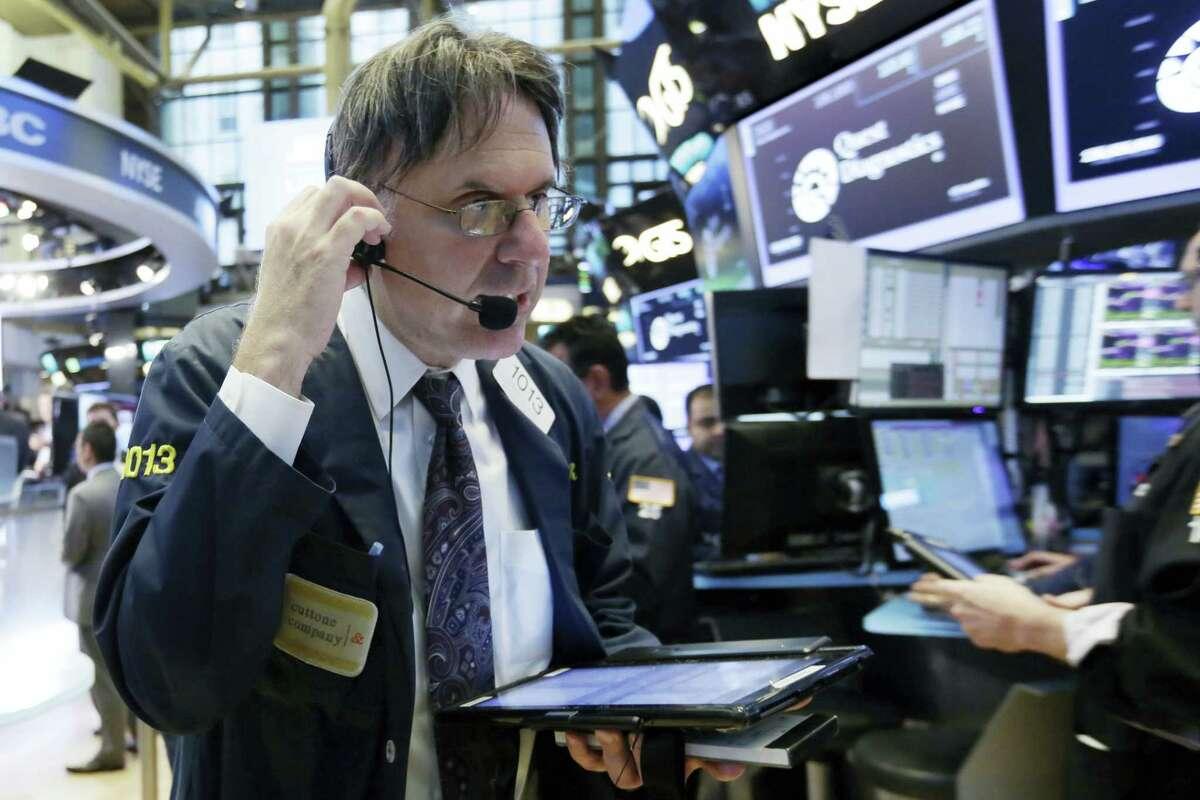 Trader Joseph Chirico works on the floor of the New York Stock Exchange Wednesday.