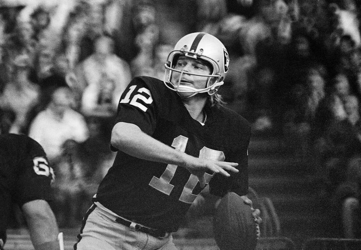 In this 1974 photo, Oakland Raiders quarterback Ken Stabler looks to pass. Research on the brains of 202 former football players has confirmed what many feared in life — evidence of chronic traumatic encephalopathy, or CTE, a devastating disease in nearly all the samples, from athletes in the NFL, college and even high school. Stabler is among the cases previously reported.