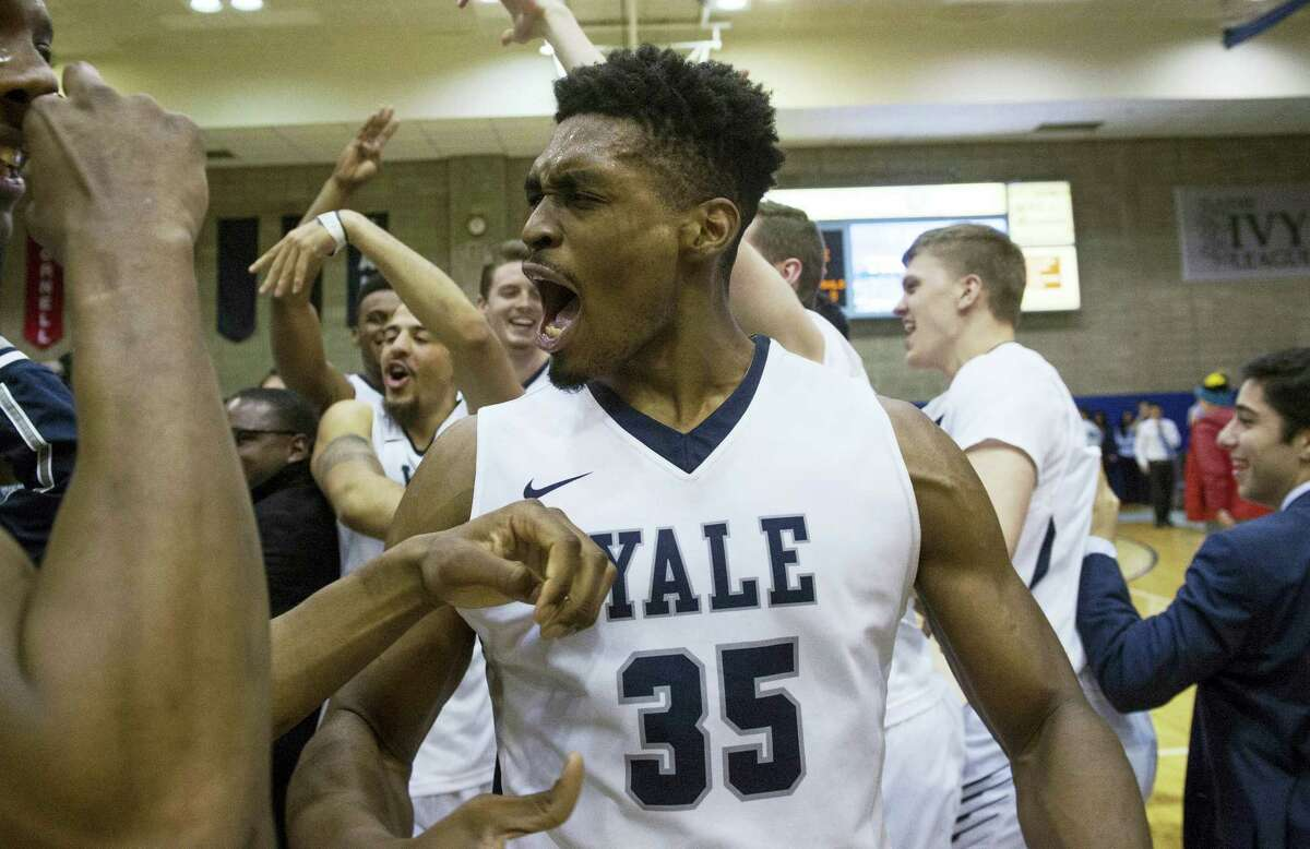 FILE - In this March 5, 2016, file photo, Yale forward Brandon Sherrod (35) celebrates the win at the end of the second half of an NCAA Ivy League Conference basketball game against Columbia, in New York. The last hold out for postseason conference tournaments has finally given in. The Ivy League is adding men's and women's basketball tournaments next season that will determine the conference's automatic berths for the NCAA Tournament. (AP Photo/Bryan R. Smith, File)