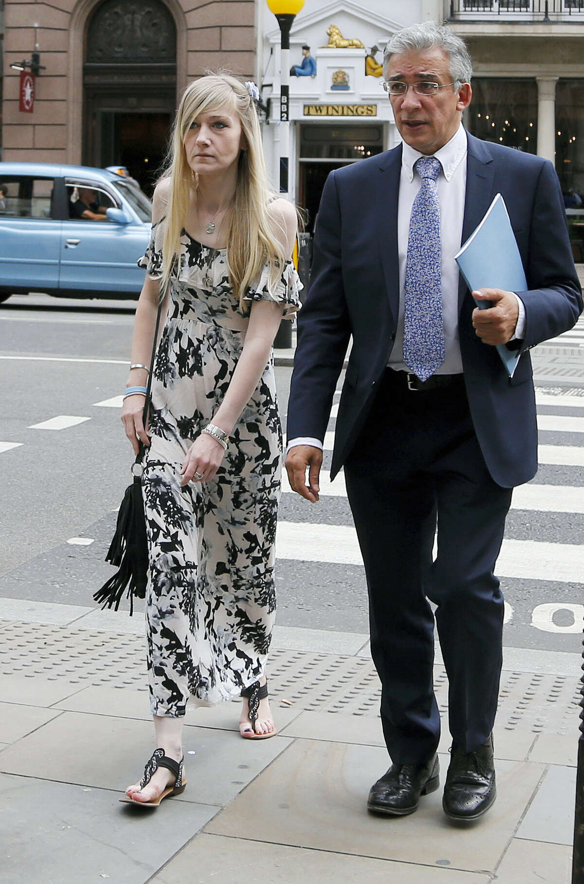 Connie Yates, mother of critically ill baby Charlie Gard arrives at the Royal Court of Justice in London, Tuesday, July 25, 2017. Lawyers for the family of critically ill infant Charlie Gard and the hospital treating him were returning to court for a hearing Tuesday, a day after the baby's parents said they were dropping their long legal battle to get him experimental treatment. The subject of Tuesday's hearing at the High Court in London was not immediately clear.