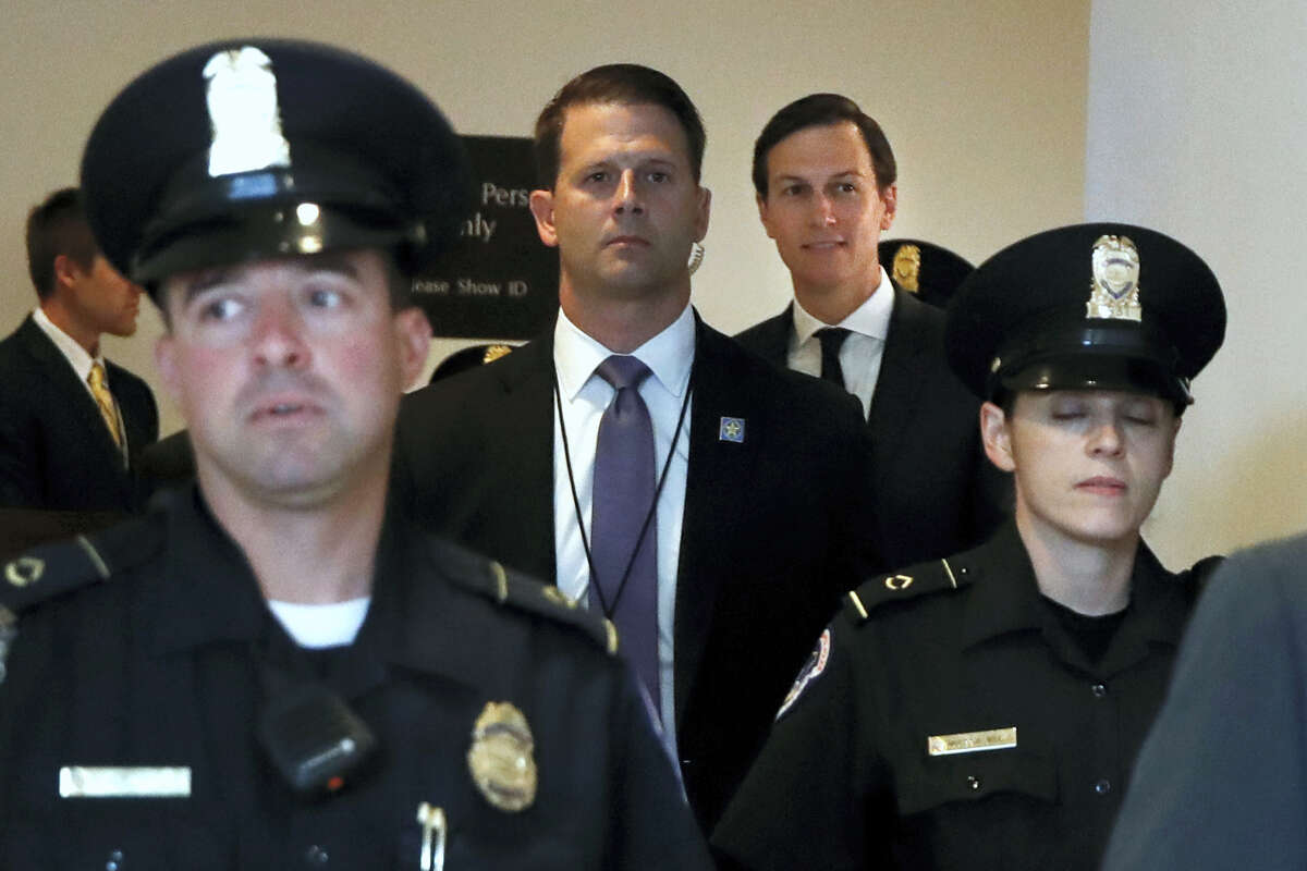 White House senior adviser Jared Kushner, second from right, is escorted by security as he arrives on Capitol Hill in Washington, Tuesday, July 25, 2017.