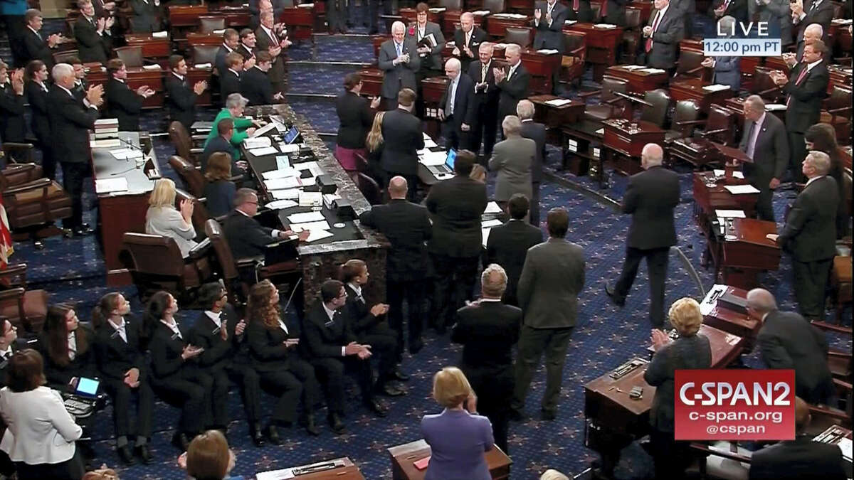 In this image from video provided by C-SPAN2, Sen. John McCain, R-Ariz. is applauded as he arrives on the floor of the Senate on Capitol Hill in Washington, Tuesday, July 25, 2017.