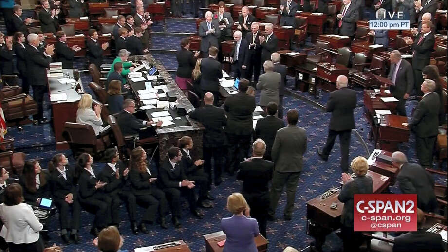 In this image from video provided by C-SPAN2, Sen. John McCain, R-Ariz. is applauded as he arrives on the floor of the Senate on Capitol Hill in Washington, Tuesday, July 25, 2017. Photo: C-SPAN2 Via AP   / C-SPAN2