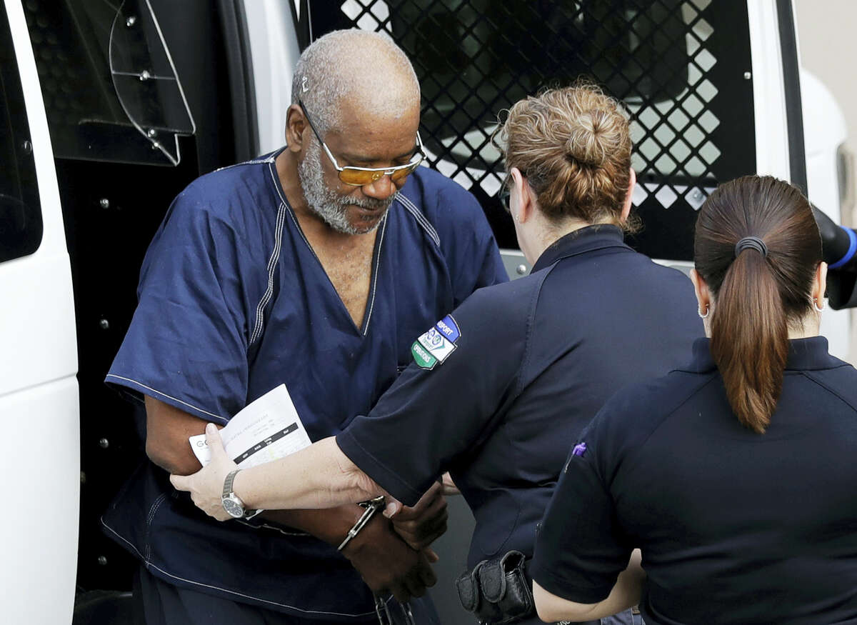 James Mathew Bradley Jr., left, arrives at the federal courthouse for a hearing, Monday, July 24, 2017, in San Antonio. Bradley was arrested in connection with the deaths of multiple people packed into a broiling tractor-trailer.