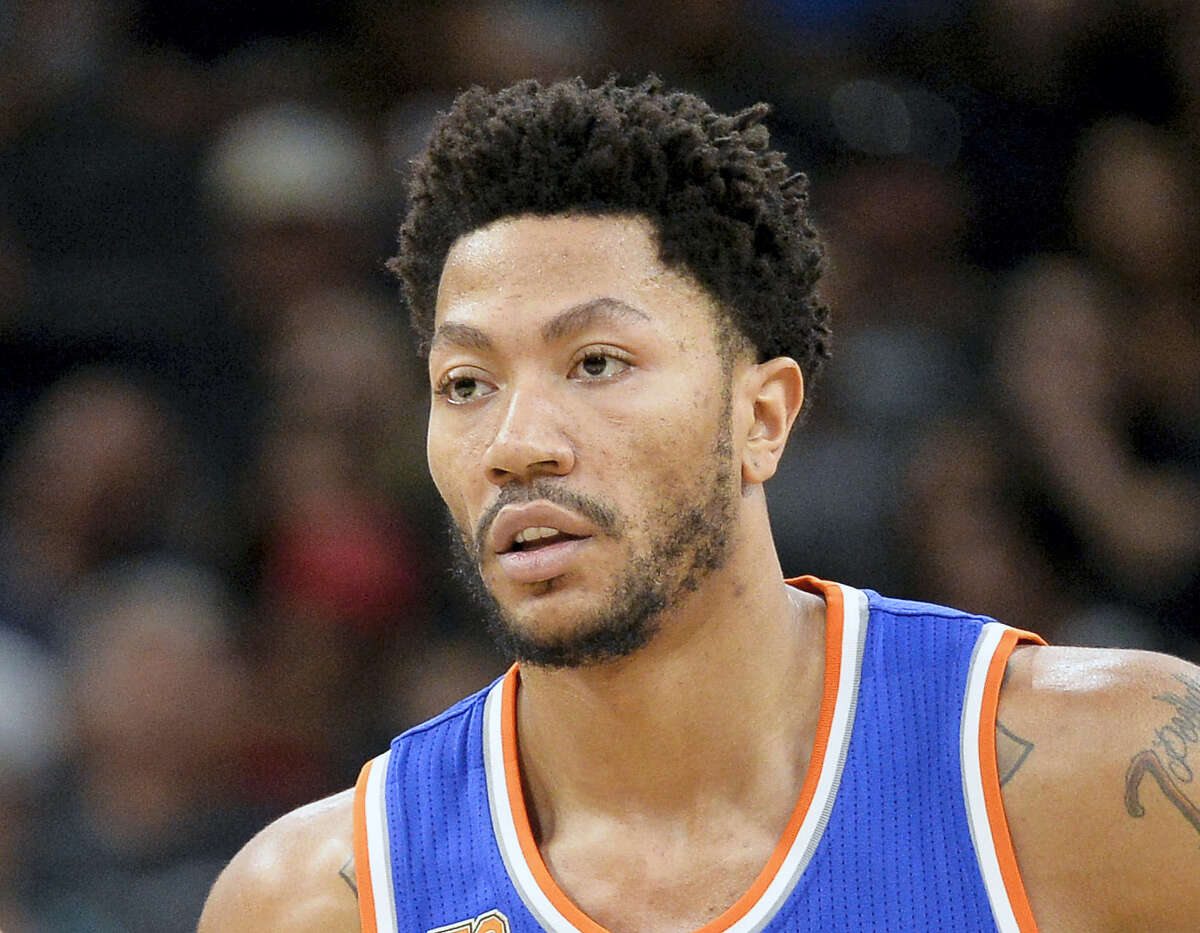 In this March 25, 2017 photo, New York Knicks' Derrick Rose stands on the court during a free throw attempt in the first half of an NBA basketball game against the San Antonio Spurs, in San Antonio. A person familiar with the negotiations says the Cleveland Cavaliers are discussing a contract with former NBA MVP Derrick Rose. The team is discussing a one-year deal with Rose, said the person who spoke Thursday, July 20, 2017, to the Associated Press on condition of anonymity because of the sensitive nature of the talks.