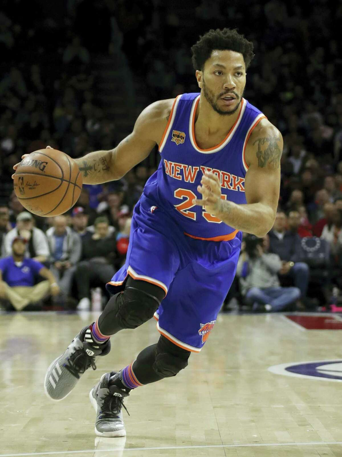 In this March 3, 2017 photo, New York Knicks' Derrick Rose drives down court during an NBA basketball game against the Philadelphia 76ers, in Philadelphia. Two people familiar with the negotiations say former MVP Derrick Rose is meeting with the Cleveland Cavaliers. Rose is discussing a potential contract with Cleveland on Monday, July 24, 2017, according to the people who spoke to The Associated Press on condition of anonymity because of the sensitive nature of the talks.