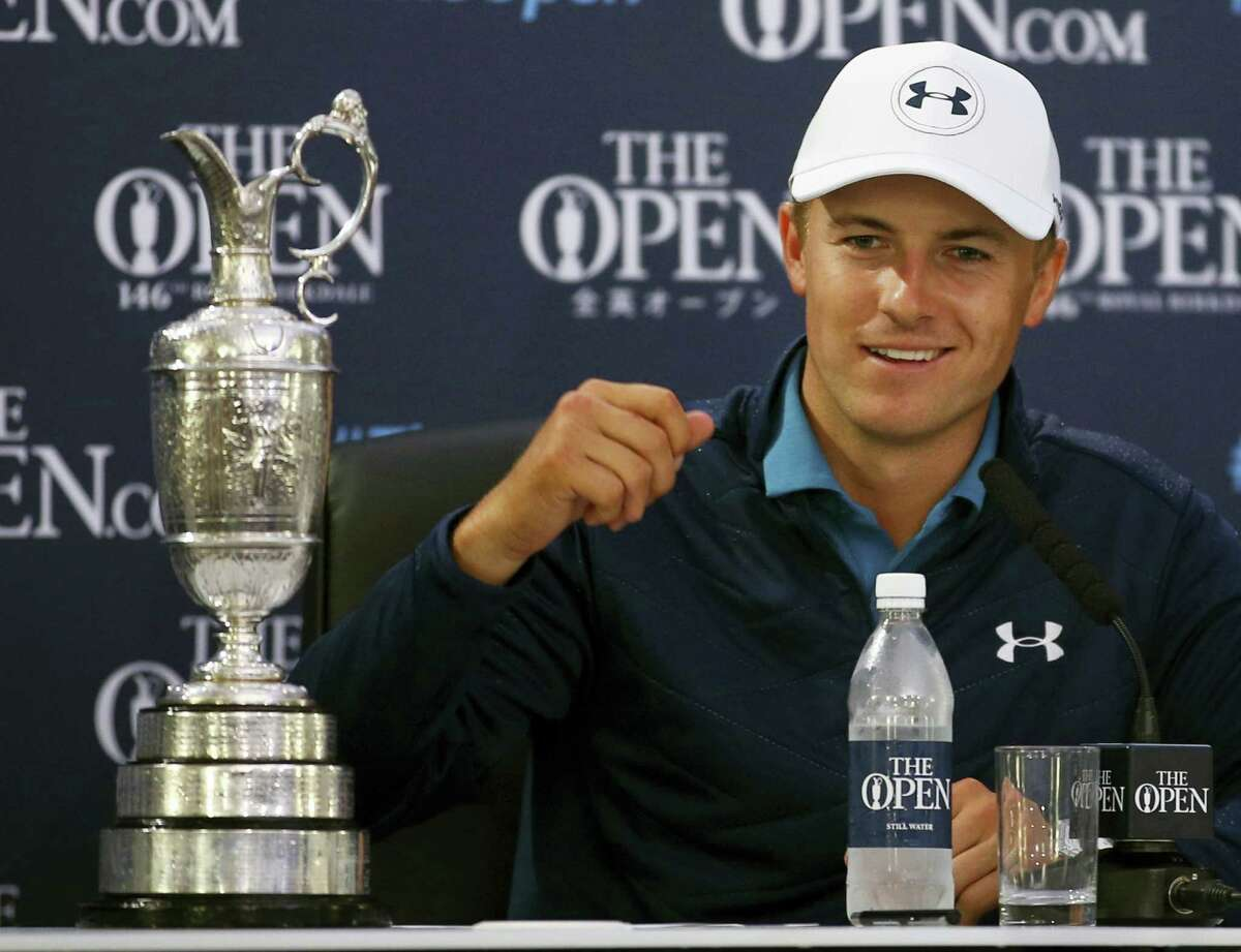 Jordan Spieth of the United States smiles during a press conference after winning the British Open Golf Championship, at Royal Birkdale, Southport, England, Sunday.