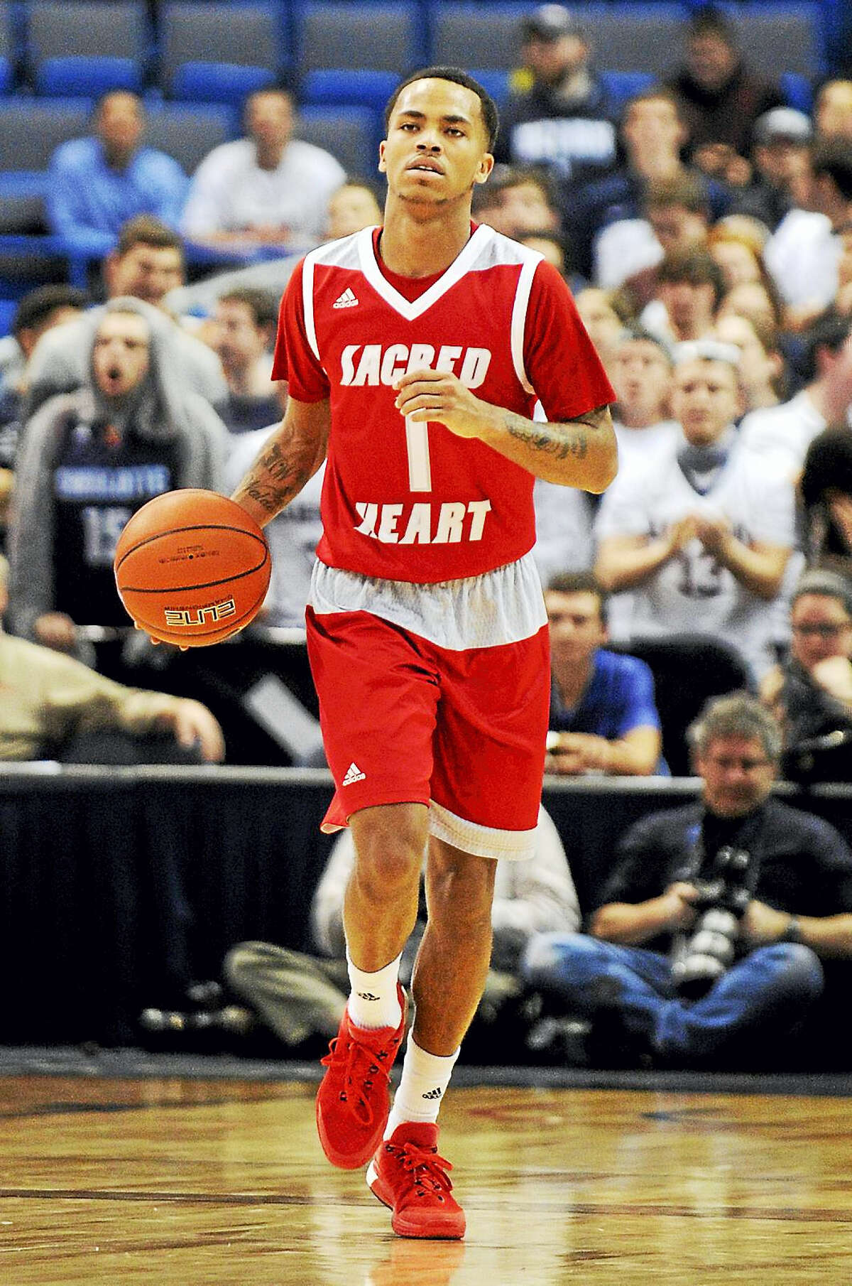 Sacred Heart's Cane Broome (1) dribbles during Connecticut's 82-49 victory over Sacred Heart in an NCAA college basketball game in Hartford, Conn., on Wednesday, Dec. 2, 2015. (AP Photo/Fred Beckham)