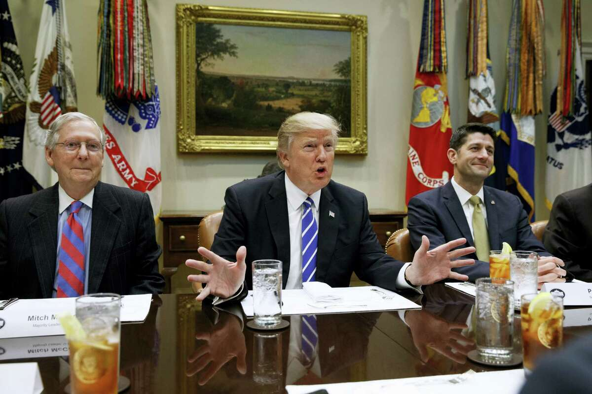 """In this March 1, 2017 photo, President Donald Trump, flanked by Senate Majority Leader Mitch McConnell of Ky., left, and House Speaker Paul Ryan of Wis., speaks during a meeting with House and Senate leadership, in the Roosevelt Room of the White House in Washington. Repeal and replace """"Obamacare."""" Just repeal. Or let it fail — maybe with a little nudge. President Donald Trump has sent a flurry of mixed messages, raising questions about the White House strategy on health care."""