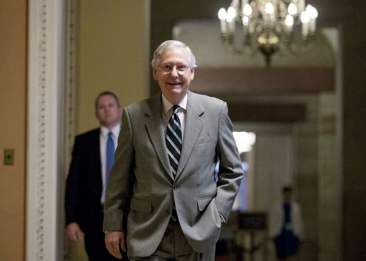 """In this July 20, 2017 photo, Senate Majority Leader Mitch McConnell of Ky. walks into the Senate Chamber at the Capitol in Washington. A brutal reality is settling over Capitol Hill: The Republican effort to repeal and replace """"Obamacare,"""" which has consumed the first six months of the Trump administration, may never yield results. Not only that, the GOP goal of overhauling the tax code requires passing a budget that is months overdue."""