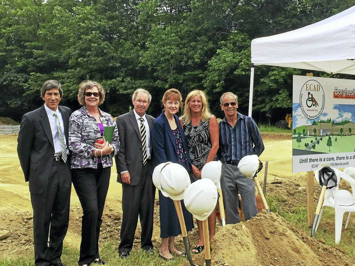 Representatives of the Draper Foundation Fund, a fund of the Northwest Connecticut Community Foundation, join ECAD co-founder, Dale Picard, during groundbreaking ceremonies for ECAD's new Canine Education and Wellness Center on June 29.