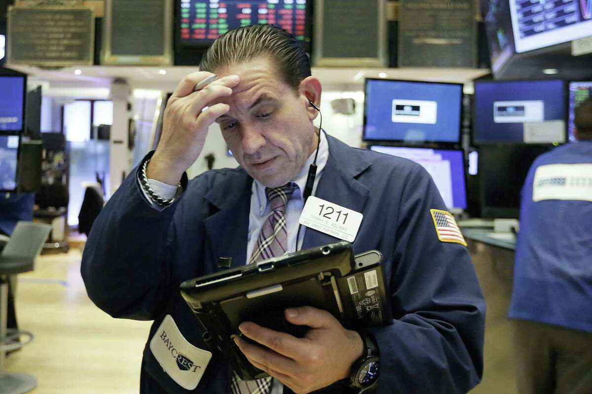 Trader Tommy Kalikas works on the floor of the New York Stock Exchange Monday.