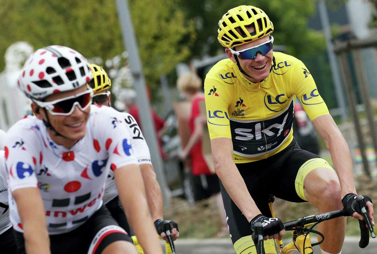 Britain's Chris Froome, wearing the overall leader's yellow jersey, and France's Warren Barguil, wearing the best climber's dotted jersey, ride during the twenty-first and last stage of the Tour de France cycling race over 103 kilometers (64 miles) with start in Montgeron and finish in Paris, France on July 23, 2017.