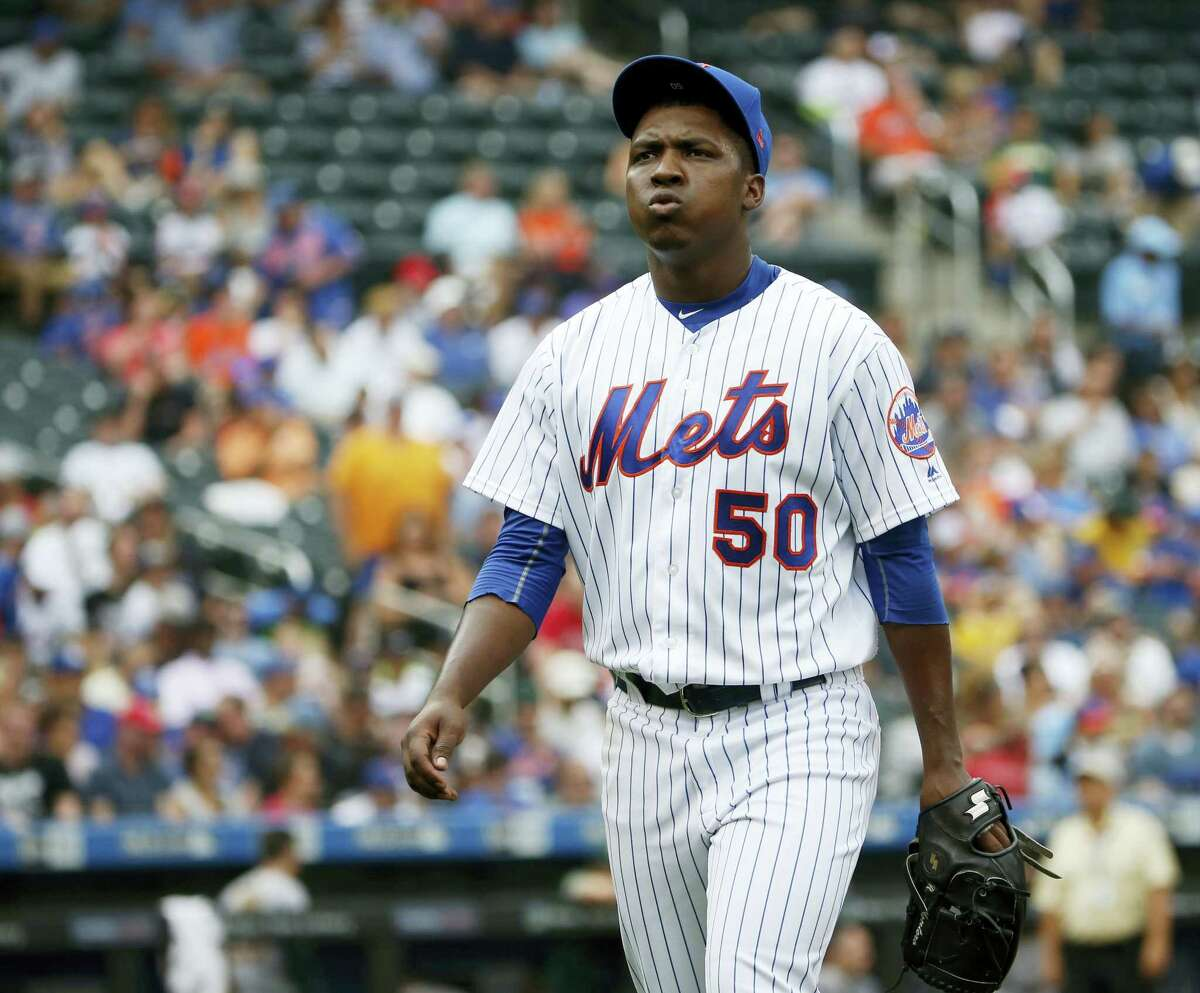 Mets starting pitcher Rafael Montero reacts as he walks toward the dugout Sunday in New York.