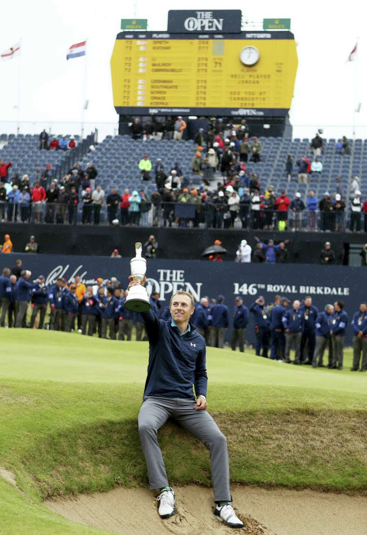 Jordan Spieth holds the claret jug after winning the British Open at Royal Birkdale on Sunday.