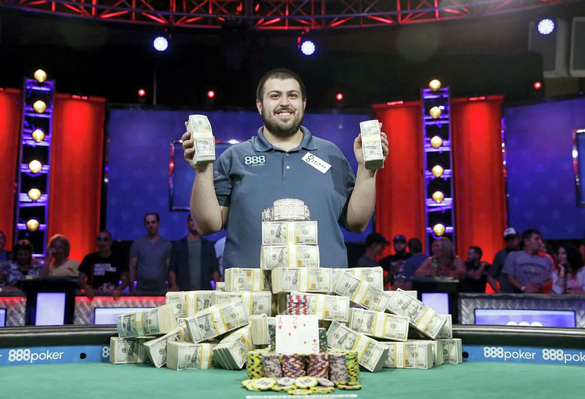 Scott Blumstein poses for photographers after winning the World Series of Poker main event on Sunday in Las Vegas.
