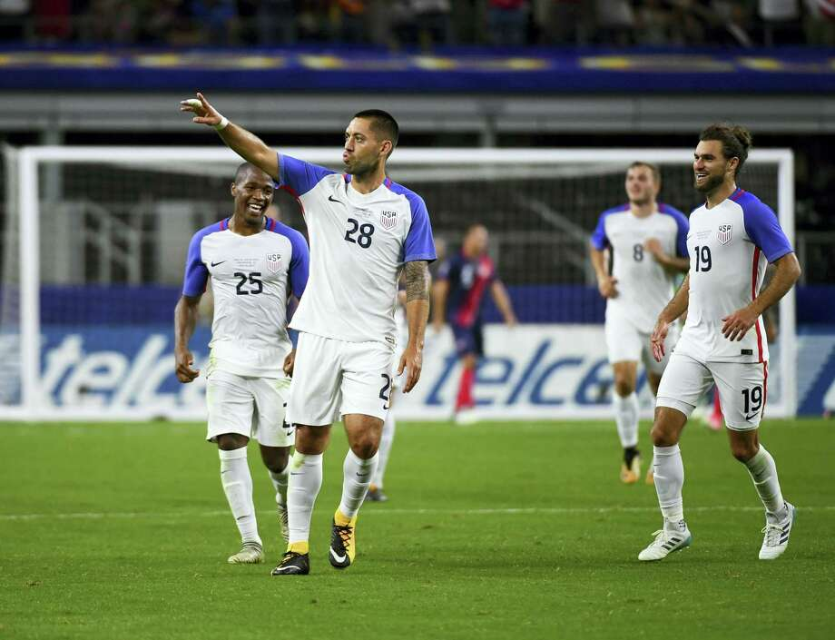 Clint Dempsey (28) celebrates with teammates after scoring a goal during a CONCACAF Gold Cup semifinal match against Costa Rica on Saturday. Photo: Jeffrey McWhorter — The Associated Press  / FR170451