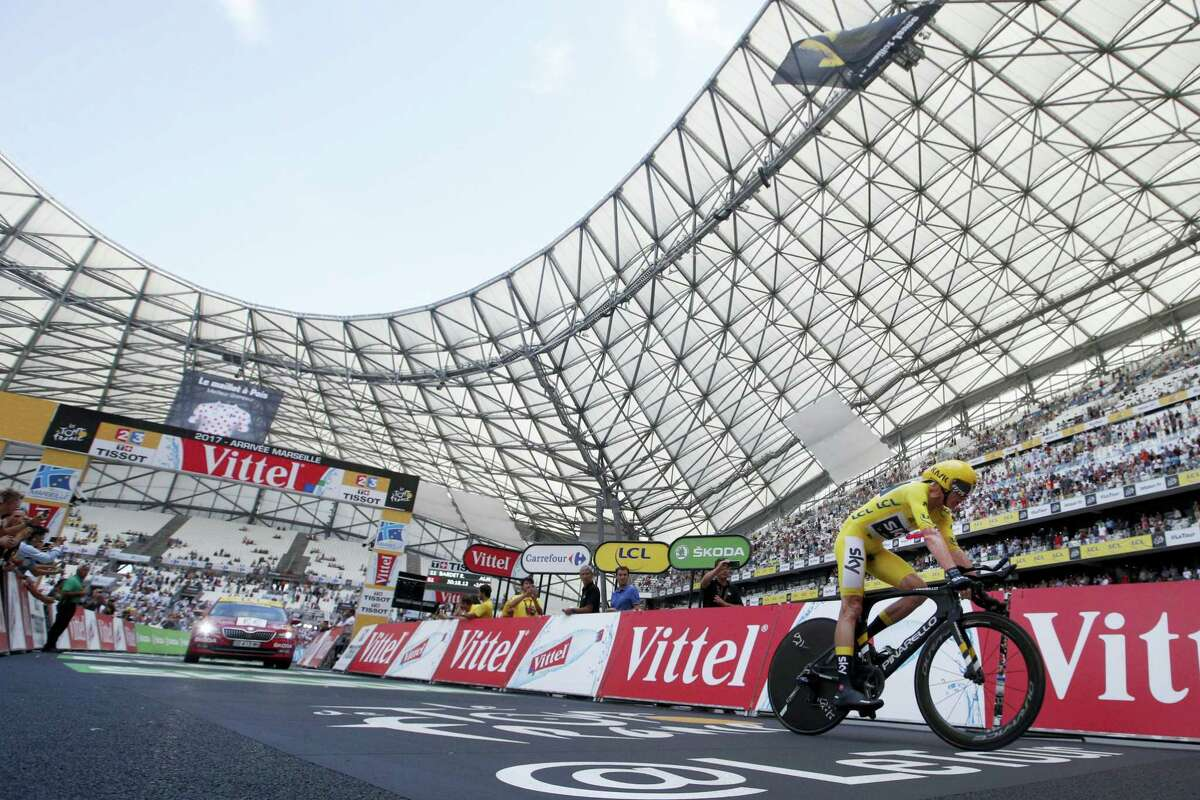 Britain's Chris Froome, wearing the overall leader's yellow jersey, crosses the finish line during the 20th stage of the Tour de France on Saturday.