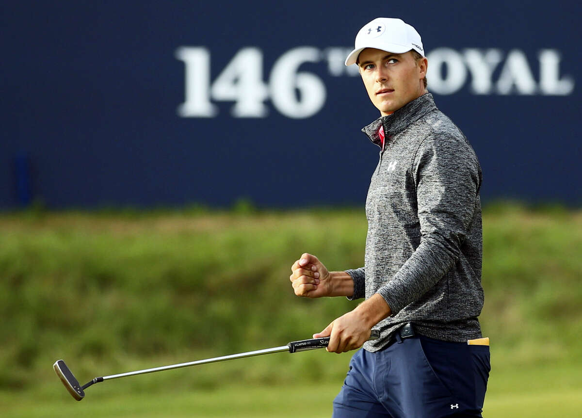 Jordan Spieth celebrates on the 18th green after the third round of the British Open on Saturday.
