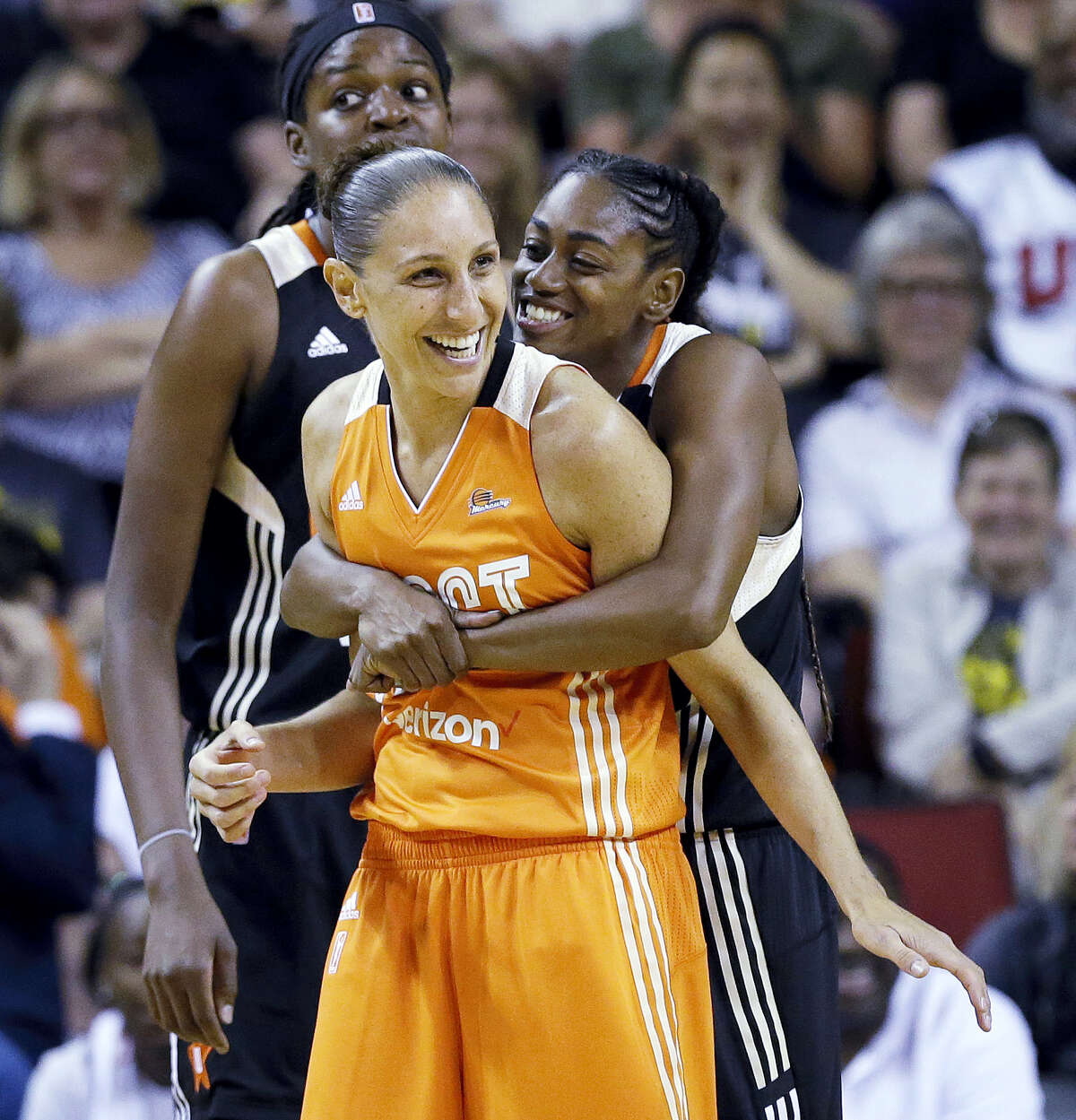 Tiffany Hayes, right, playfully puts a bear hug on Diana Taurasi after a foul by Taurasi during the second half of the WNBA All-Star game on Saturday in Seattle.
