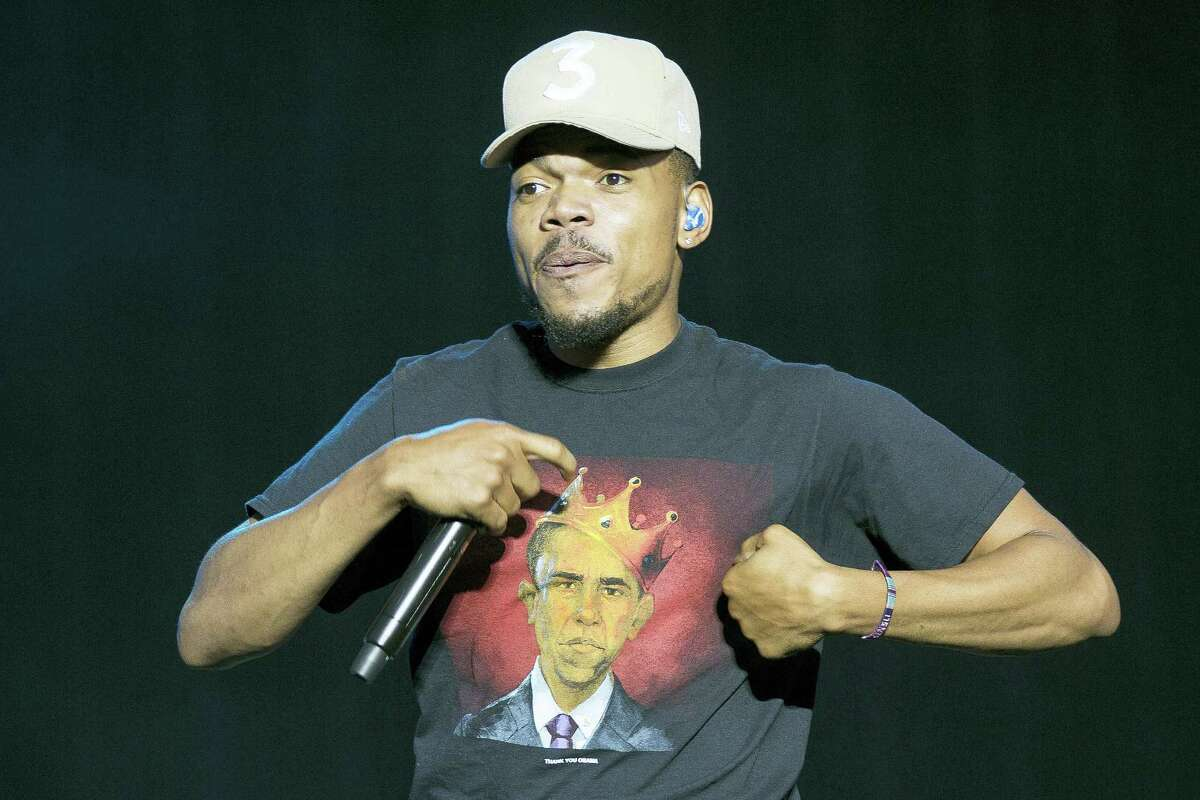 In this July 7, 2017 file photo, Chance the Rapper performs on stage at the Wireless Festival in Finsbury Park, London. Police in Connecticut say more than 90 people were hospitalized during a concert featuring Chance the Rapper. Hartford Deputy Chief Brian Foley said Saturday, July 22 that officers made 50 underage drinking referrals Friday at Hot 93.7's Hot Jam concert at Xfinity Theatre. Most of those charged were issued a summons to appear in court. Several other arrests were made throughout the evening.