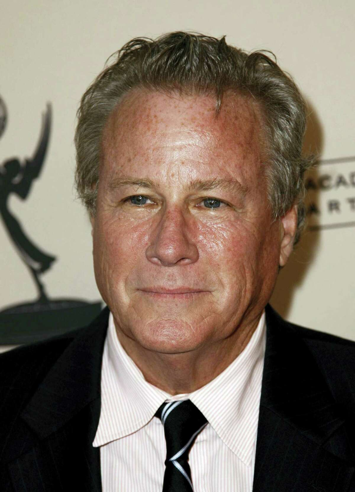 In this Sept. 12, 2011, file photo, actor John Heard arrives at Academy of Television Arts and Sciences Producers Peer Group celebration of the 63rd Primetime Emmy Awards in Los Angeles. Heard, best known for playing the father in the 'Home Alone' movie series, has died. He was 71. His death was confirmed by the Santa Clara Medical Examiner's Office in California on Saturday, July 22, 2017.