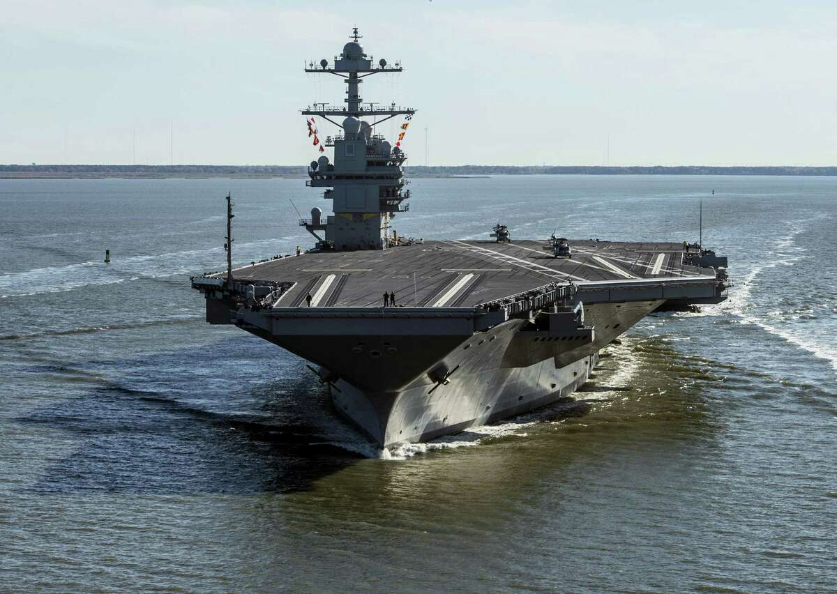 In this April 8, 2017, file photo provided by the U.S. Navy, the USS Gerald R. Ford embarks on the first of its sea trials to test various state-of-the-art systems on its own power for the first time from Newport News, Va. The Navy's newest aircraft carrier will officially join the fleet Saturday, July 22, 2017, at a commissioning overseen by President Donald Trump. But four years will likely pass before the ship's first deployment as the ship still must go through various tests and trials of its new state-of-the-art technology.