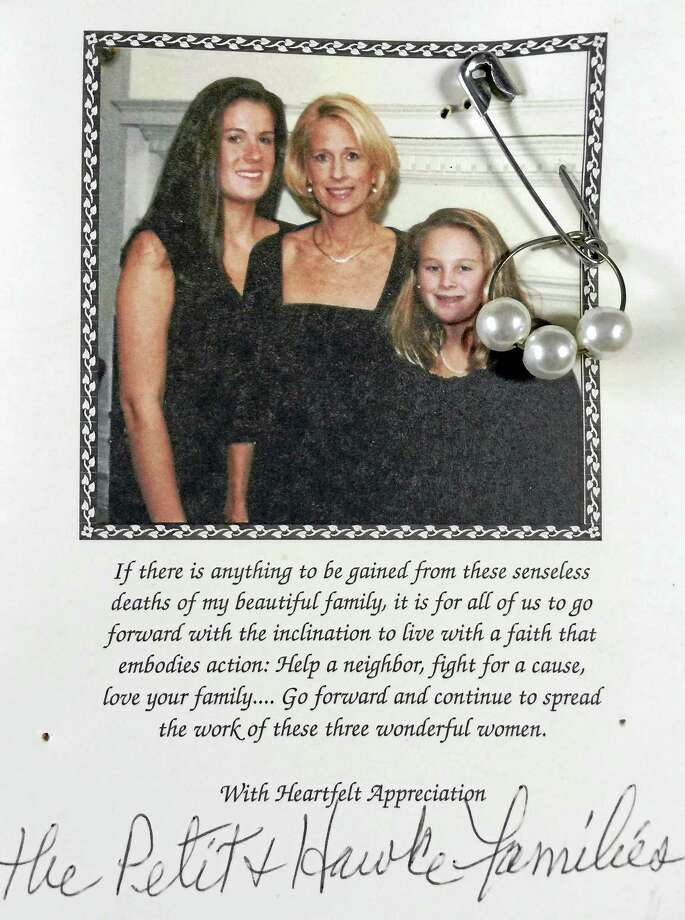 Harriet Linder has a bulletin board in her home that serves as a reminder of the Petit family. Part of the space on it is reserved for a thank you card for a donation her family made to The Petit Family Foundation.  Attached to it is  A safety pin with a loop of metal through the bottom. Attached to it is a metal loop with three faux pearls, one for each of the Petit woman. Epstein distributed the pins to neighbors in a show of solidarity with the familyContributed photo Photo: Digital First Media