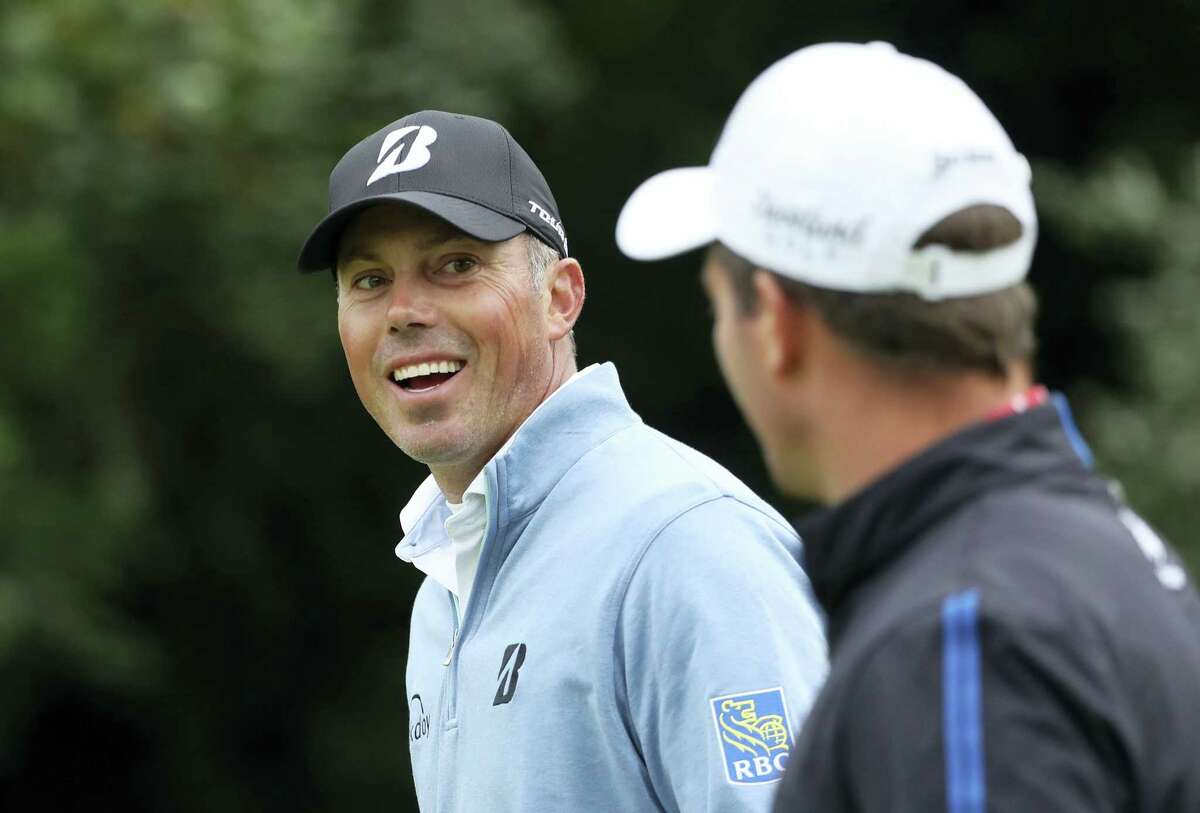 Matt Kuchar of the United States, left, walks along the 5th fairway with New Zealand's Ryan Fox during the second round of the British Open Golf Championship, at Royal Birkdale, Southport, England, Friday.