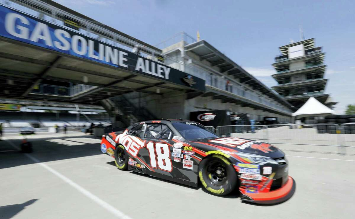 Kyle Busch pulls into the garage during practice at Indianapolis Motor Speedway.