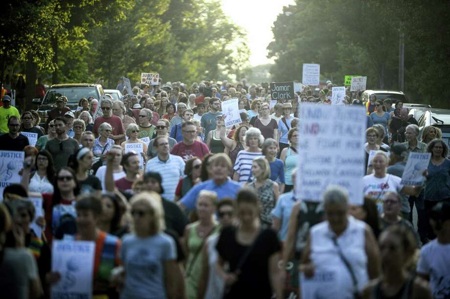 Hundreds march from the site of Justine Damond's shooting to Beard's Plaissance Park during a march in honor of Damond Thursday, July 20, 2017, in Minneapolis. Damond, of Australia, was shot and killed by a Minneapolis police officer on Saturday, July 15, after calling 911 to report what she believed was a possible assault. Photo: Aaron Lavinsky /Star Tribune Via AP  / ' 2017 Aaron Lavinsky /Star Tribune