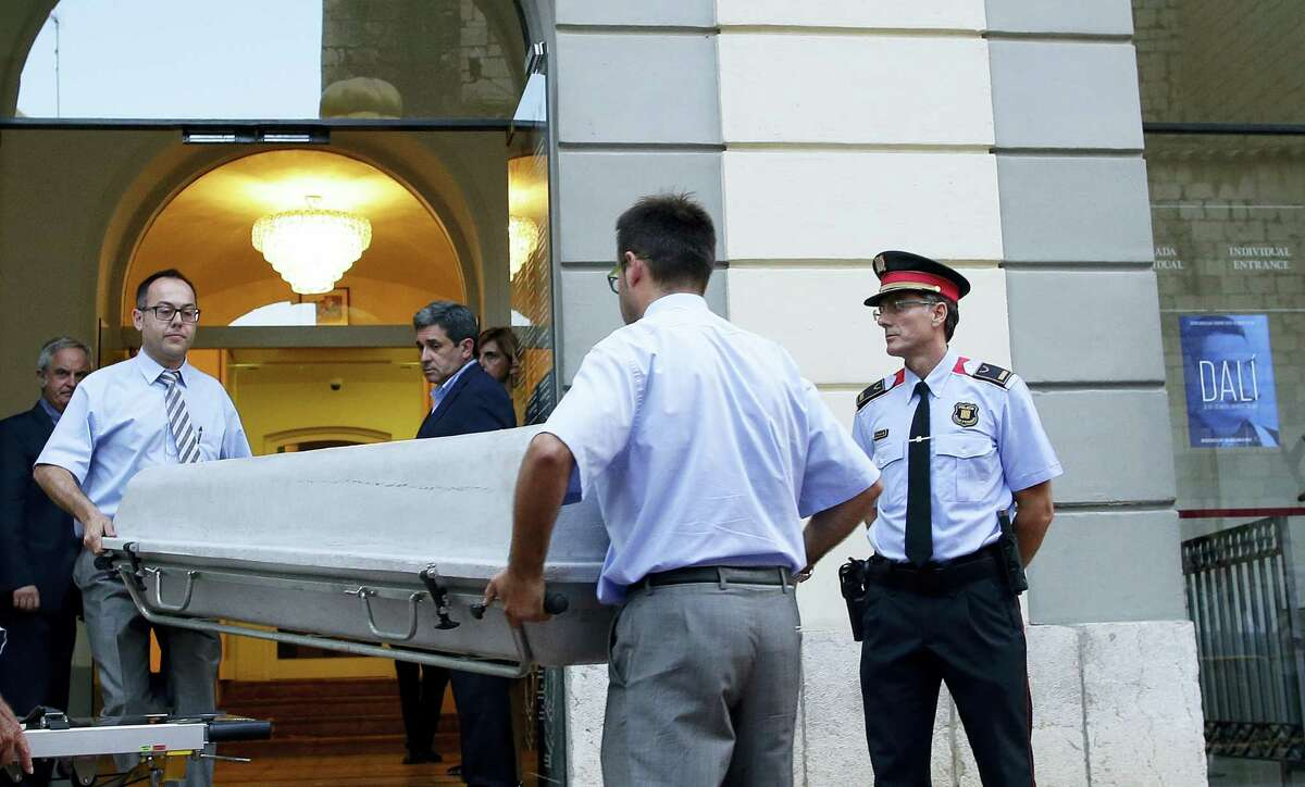 Workers bring a casket to the Dali Theater Museum in Figueres, Spain, Thursday, July 20, 2017. Salvador Dali's eccentric artistic and personal history took yet another bizarre turn Thursday with the exhumation of his embalmed remains in order to find genetic samples that could settle whether one of the founding figures of surrealism fathered a daughter decades ago.