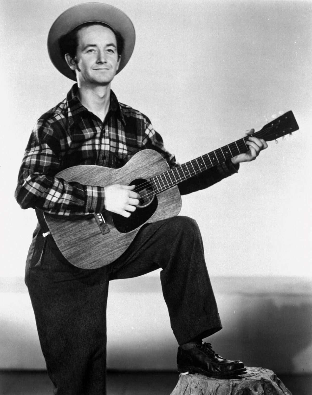 Guthrie, pictured in 1947, penned several songs tackling racism, including one aimed at President Donald Trump's father.