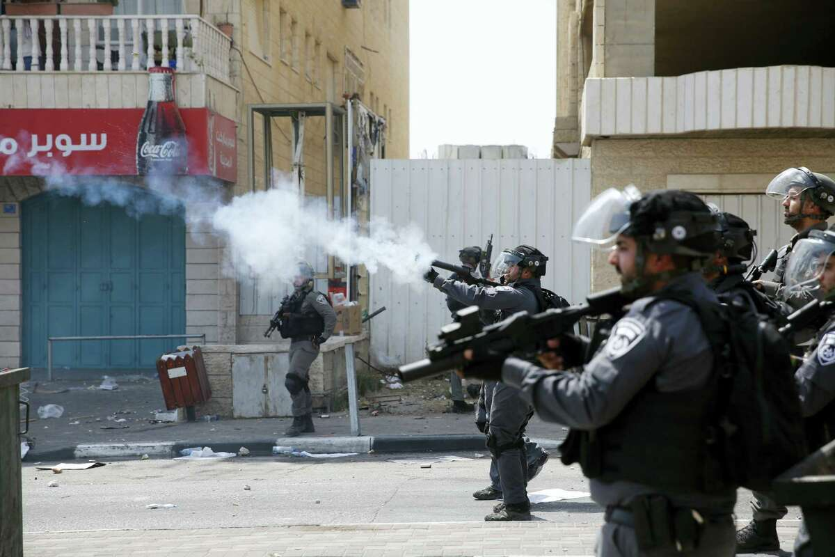 Israeli border police fire tear gas at Palestinians during clashes in the West Bank city of Bethlehem, Friday, July 21, 2017. Israel police severely restricted Muslim access to a contested shrine in Jerusalem's Old City on Friday to prevent protests over the installation of metal detectors at the holy site.