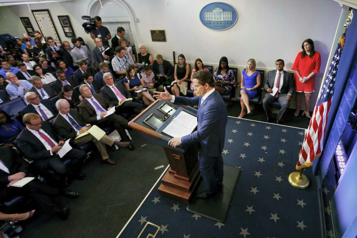 Sarah Huckabee Sanders, right, who has been named White House press secretary listens to incoming White House communications director Anthony Scaramucci, center, answer questions during the press briefing in the Brady Press Briefing room of the White House in Washington, Friday, July 21, 2017.