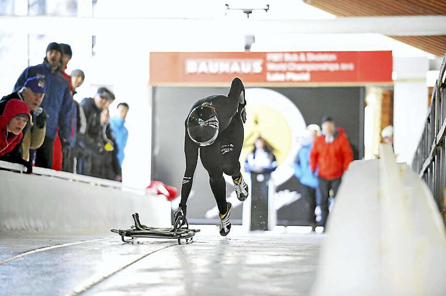 Megan Henry, a Roxbury native, is raising money to fund her Olympic dreams. Her chosen sport is skeleton, a form of competitive sledding, shown abot. Photo: CONTRIBUTED PHOTO Courtesy Of Megan Henry