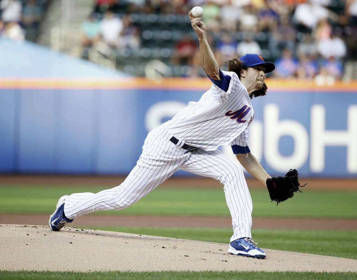 New York Mets' Jacob deGrom delivers a pitch during the first inning of the team's baseball game against the St. Louis Cardinals on Wednesday, in New York.
